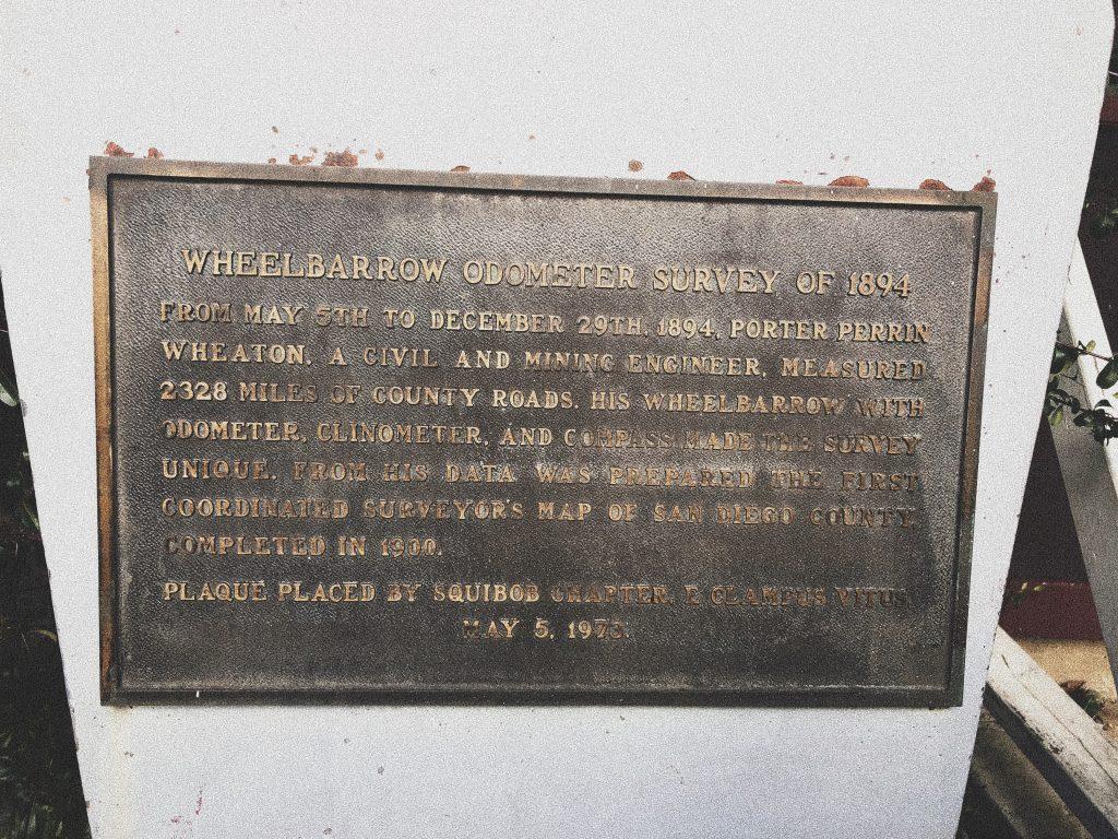 Wheelbarrow with historical marker