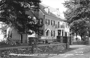 Old back and white photo post card of the house.