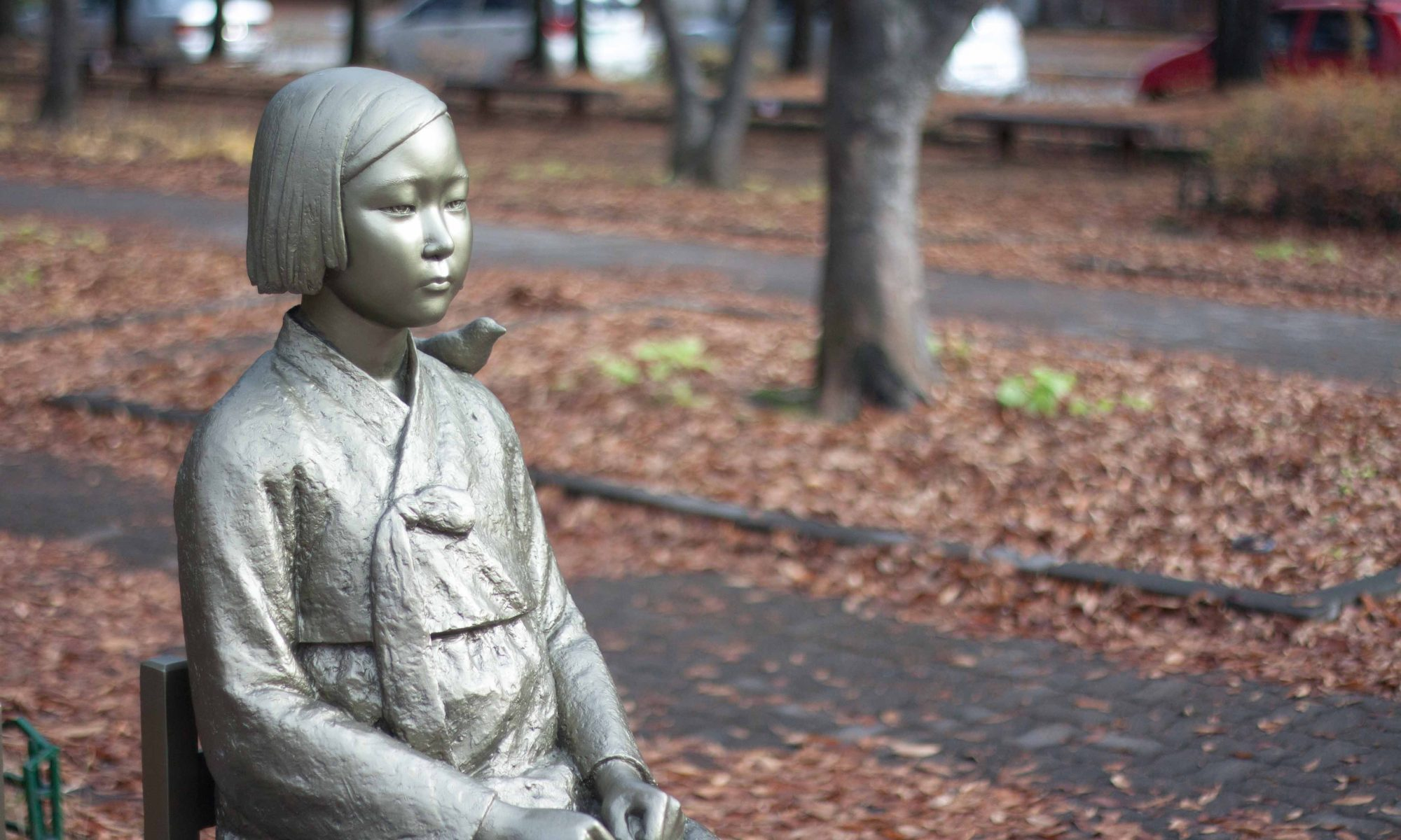 Statue of a young girl sitting